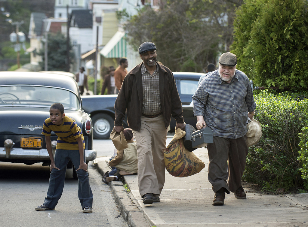 """This image released by Paramount Pictures shows Denzel Washington, center, and Stephen McKinley Henderson, right, in a scene from, """"Fen..."""