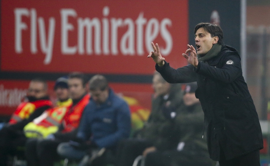FILE - In this Saturday, Dec. 17, 2016 filer, AC Milan coach Vincenzo Montella follows a Serie A soccer match between AC Milan and Atal...