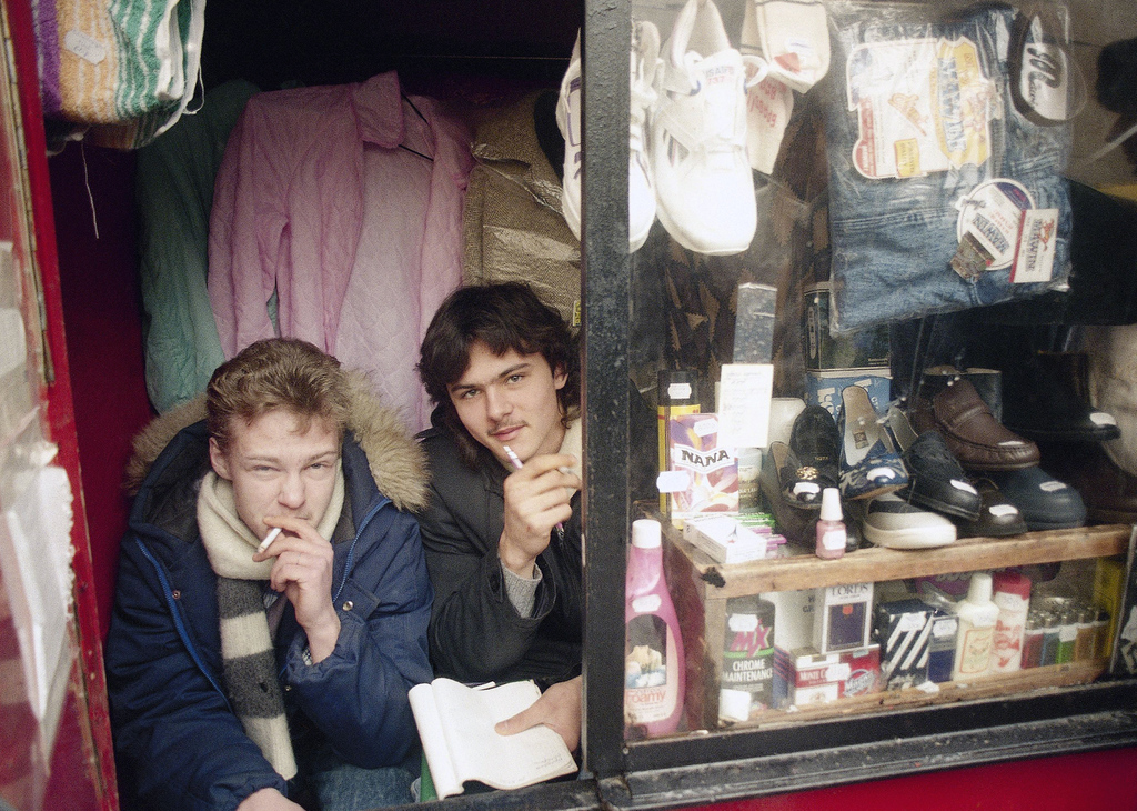 FILE - In this Friday, Jan. 24, 1992 file photo, two men sit in a kiosk selling clothes and shoes in downtown Moscow, Russia. AP's Nata...