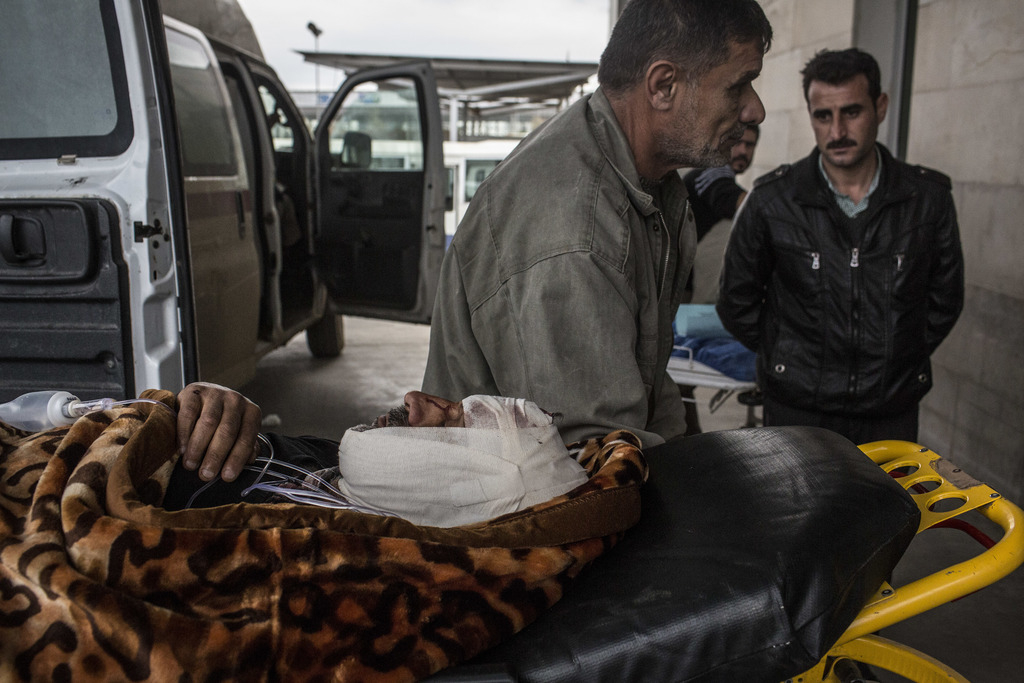 A Iraqi man wounded in a car bomb attack in the liberated district of Gogjali is seen at his arrival to a Hospital in Irbil, Iraq, Thur...