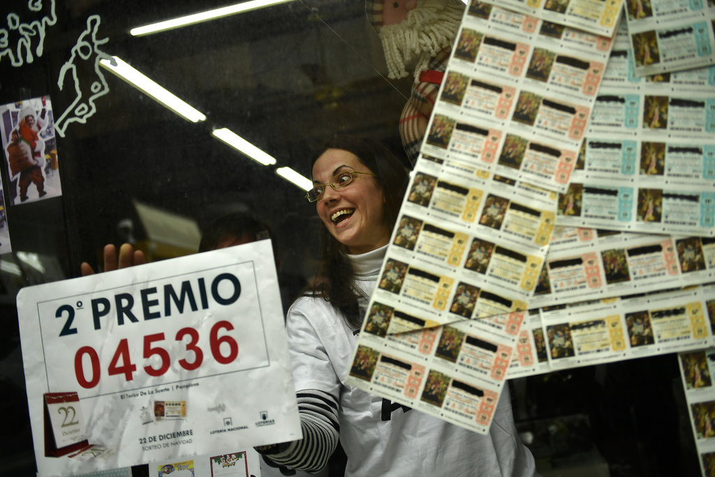 Monica celebrates in her lottery office after selling the second Christmas lottery prize ''El Gordo'' with the number 04536, in Pamplon...