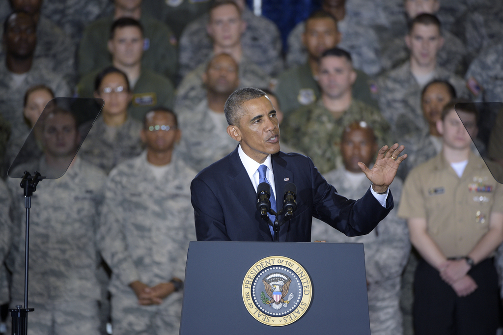 FILE - In this Sept. 17, 2014, file photo, President Barack Obama speaks to military personnel at U.S. Central Command at MacDill Air F...