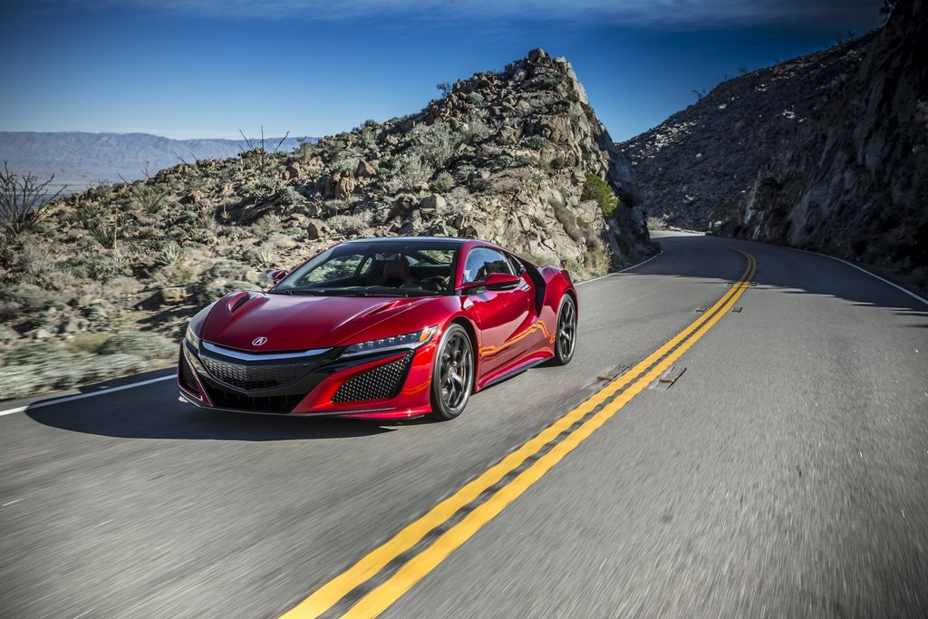 This photo provided by Honda shows the 2017 Acura NSX. The Acura NSX returns for 2017 after a 12-year absence as the first gasoline-ele...