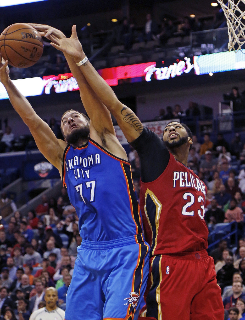 Oklahoma City Thunder center Joffrey Lauvergne (77) grabs a rebound against New Orleans Pelicans forward Anthony Davis (23) during the ...