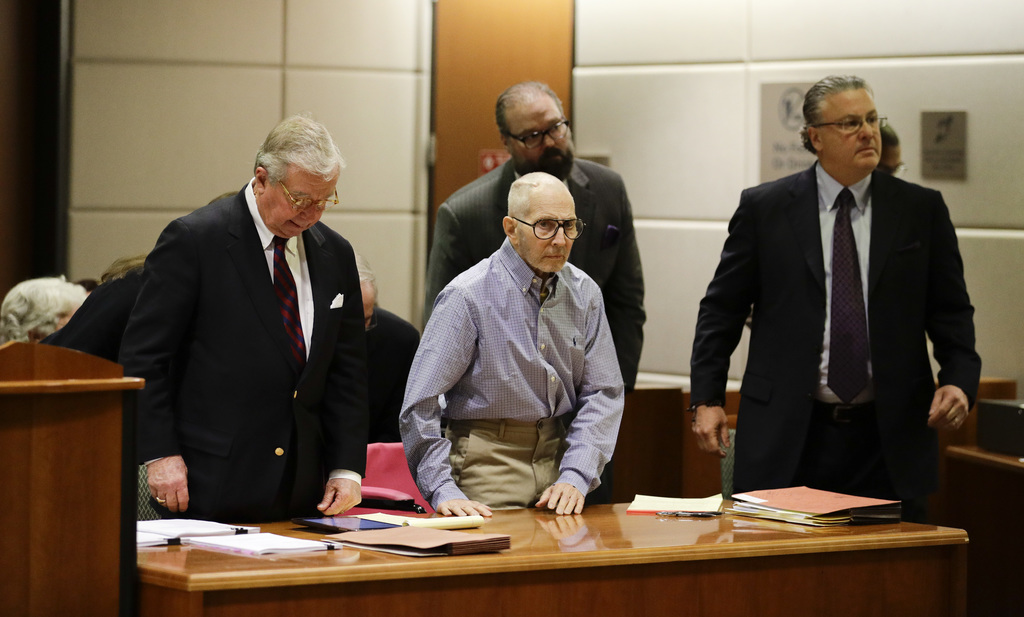 Real estate heir Robert Durst, center, appears in a courtroom for a hearing with his attorneys, Dick DeGuerin, left, and David Chesnoff...