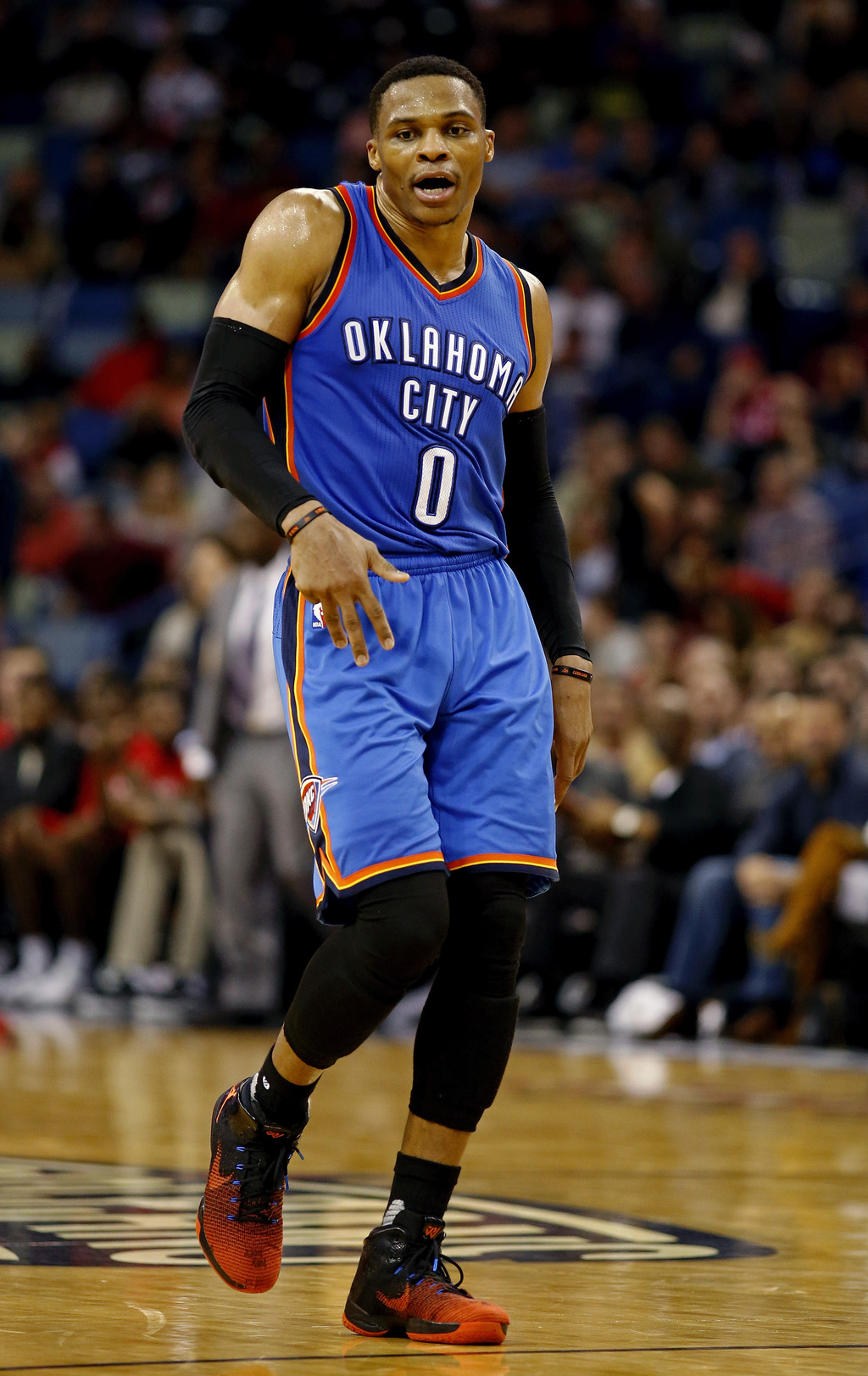Oklahoma City Thunder guard Russell Westbrook dances between plays during the second half of the team's NBA basketball game against the...
