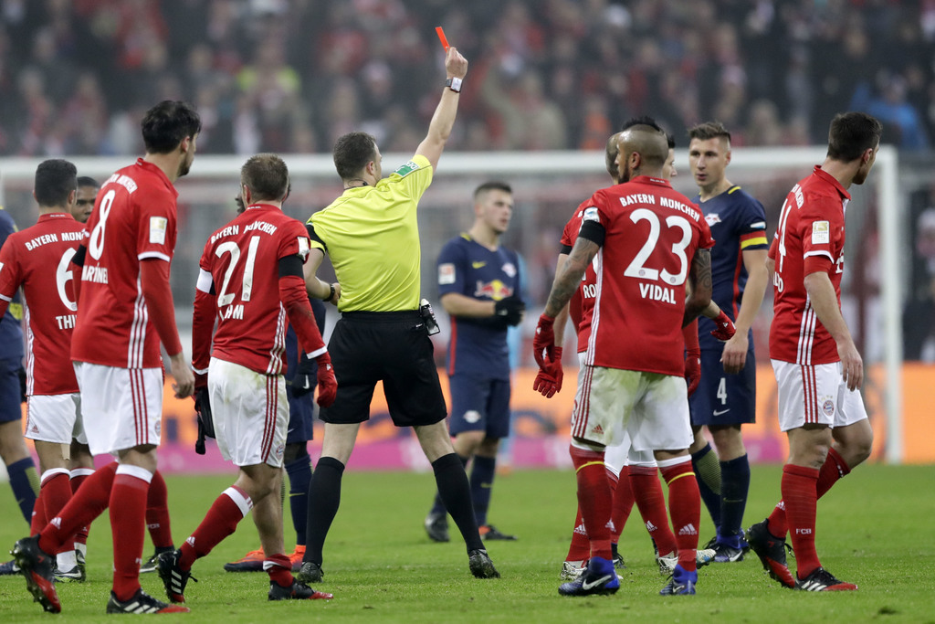 Referee Felix Zwayer shows the red card to Leipzig's Emil Forsberg during the German Bundesliga soccer match between FC Bayern Munich a...