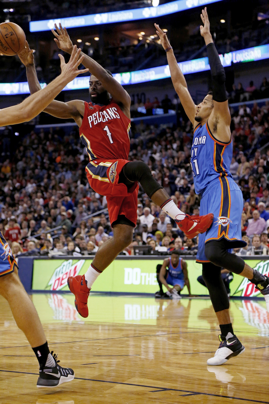 New Orleans Pelicans guard Tyreke Evans (1) passes the ball after being blocked at the basket by Oklahoma City Thunder forward Andre Ro...