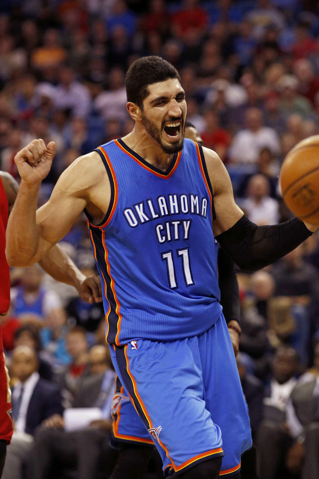 Oklahoma City Thunder center Enes Kanter reacts to his team making a basket against the New Orleans Pelicans during the first half of a...