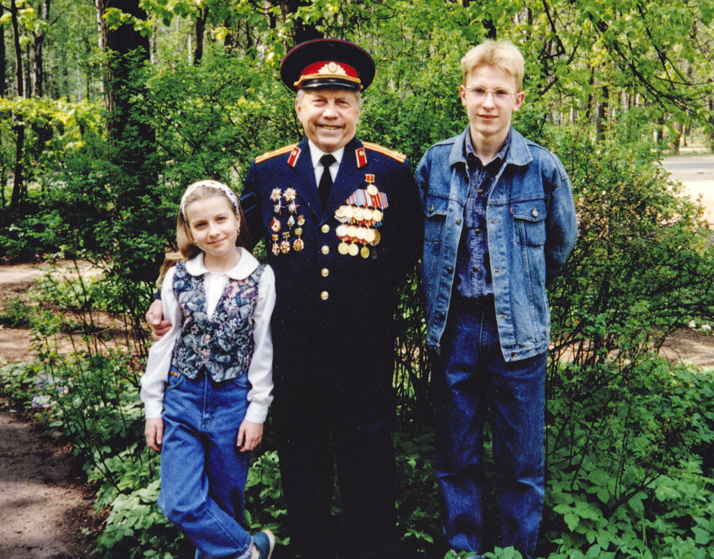 In this 1995 family handout photo, Nataliya Vasilyeva, left, stands with her grandfather, center, and brother in Pushkino outside Mosco...