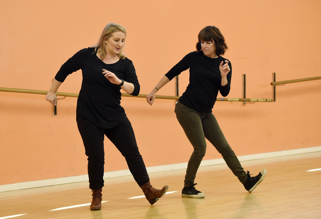 """In this Dec. 19, 2016 photo, Mandy Moore, left, choreographer for """"La La Land,"""" teaches dance moves from the film to Associated Press r..."""