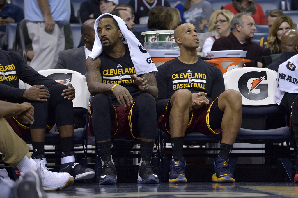 FILE - In this Dec. 14, 2016, file photo, Cleveland Cavaliers guard J.R. Smith, left, and forward Richard Jefferson (24) sit next to em...