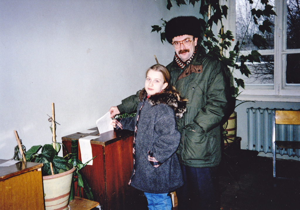 In this family handout photo, Nataliya Vasilyeva, left, and her father cast a ballot in the parliamentary election on Dec. 17, 1995, in...