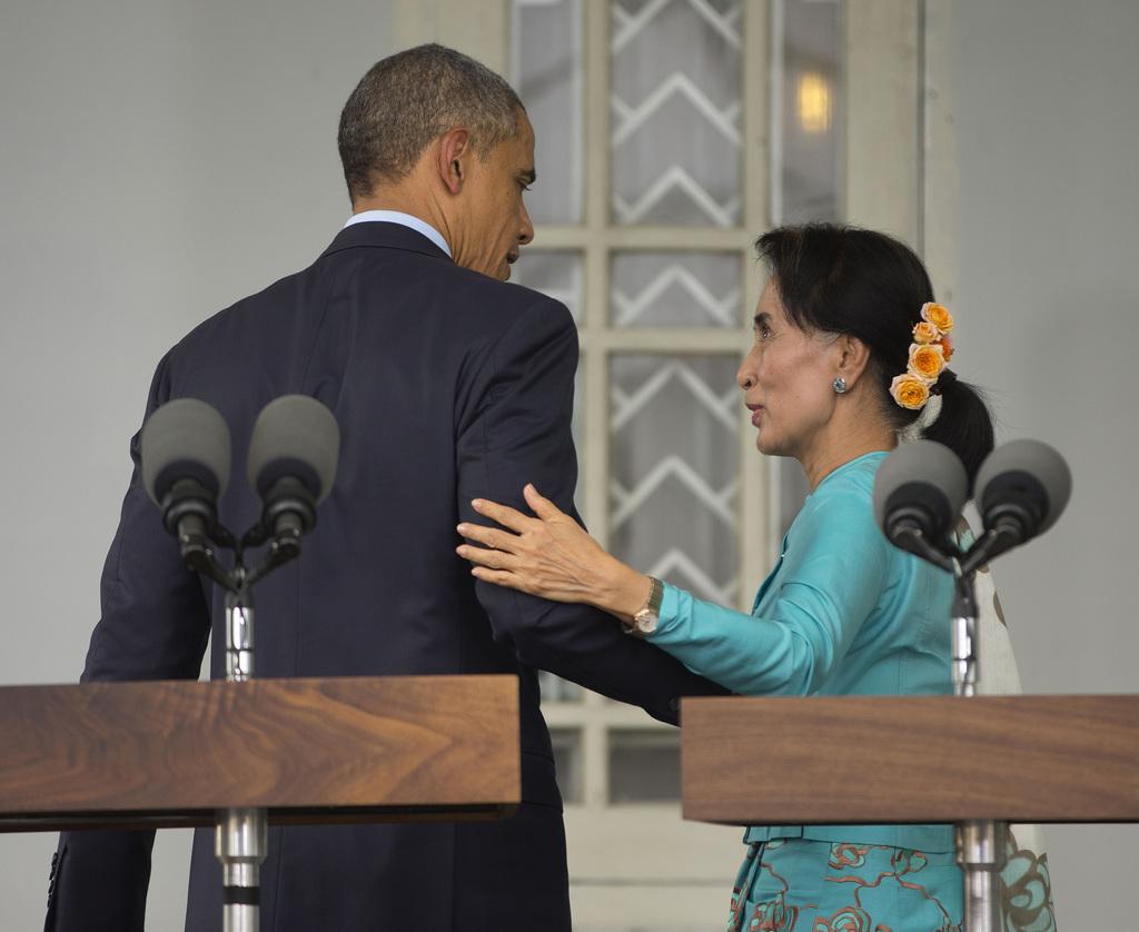 FILE - In this Nov. 14, 2014, file photo, U.S. President Barack Obama, left, with Myanmar's opposition leader Aung San Suu Kyi walks ba...
