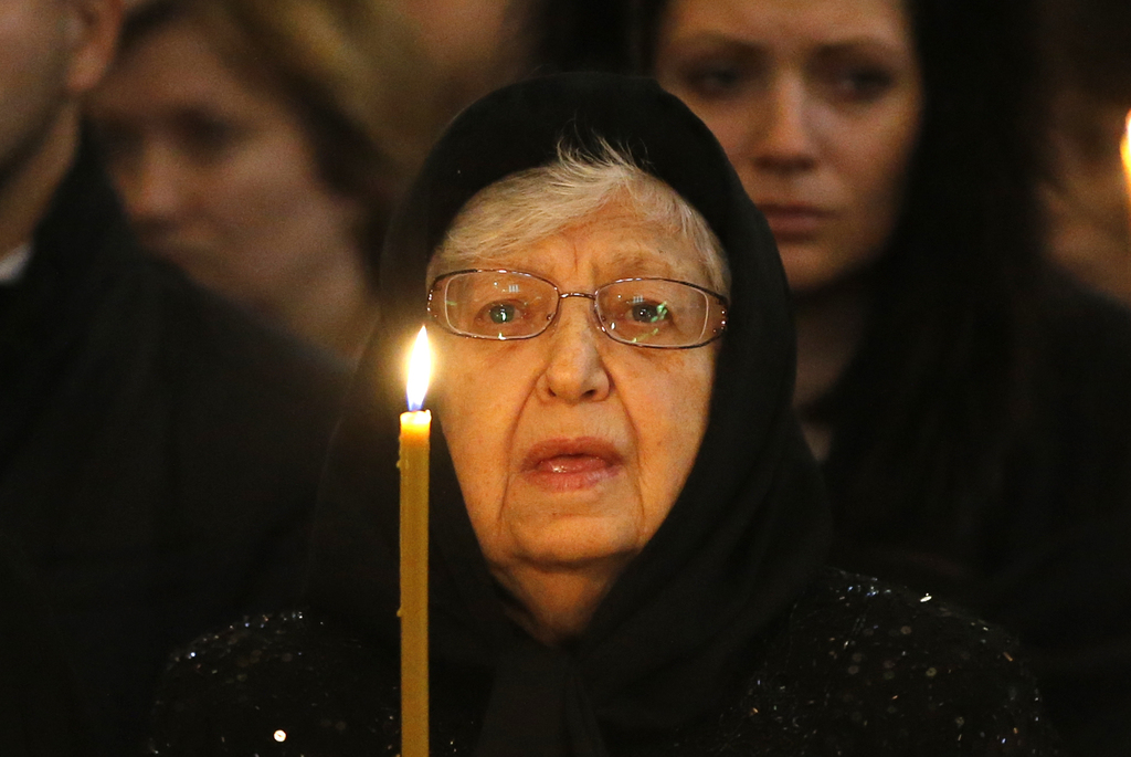 Mother of Andrei Karlov, Maria holds a candle during a religious service for killed Russian ambassador to Turkey, Andrei Karlov inside ...