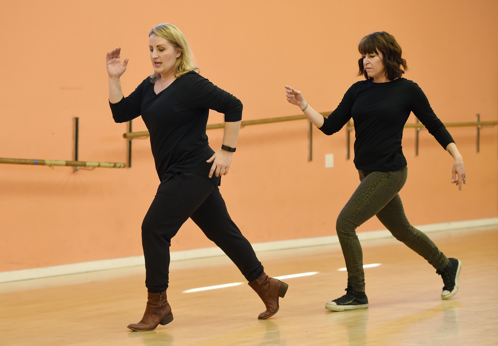 """In this Monday, Dec. 19, 2016 photo, Mandy Moore, left, choreographer for """"La La Land,"""" teaches dance moves from the film to Associated..."""