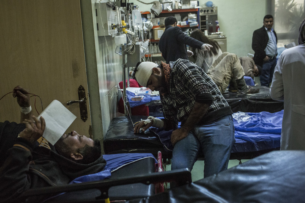 A Iraqi men wounded in a car bomb attack in the liberated district of Gogjali in Mosul are seen in a emergency room at a Hospital in Ir...