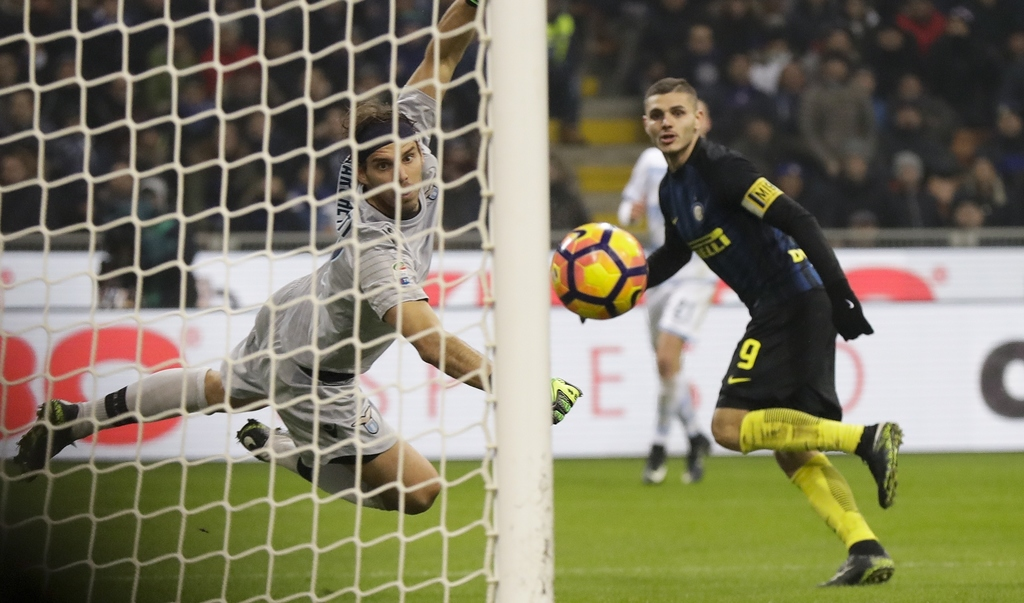 Inter Milan's Mauro Icardi scores past Lazio goalkeeper Federico Marchetti during a Serie A soccer match between Inter Milan and Lazio,...