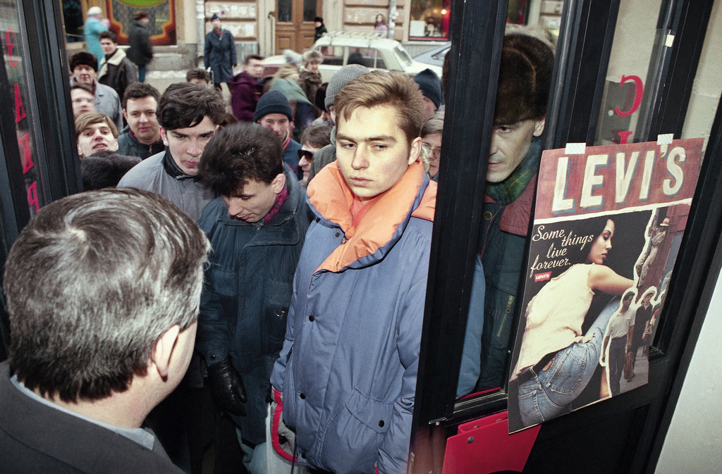 FILE - In this Feb. 19, 1993 file photo, hundreds of young people line up waiting to get into the newly-opened Levi Strauss and Co. sto...