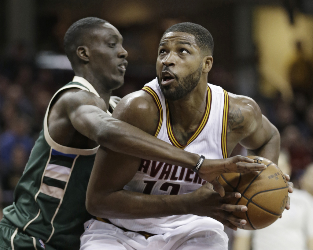 Milwaukee Bucks' Tony Snell, left, fouls Cleveland Cavaliers' Tristan Thompson during the first half of an NBA basketball game, Wednesd...