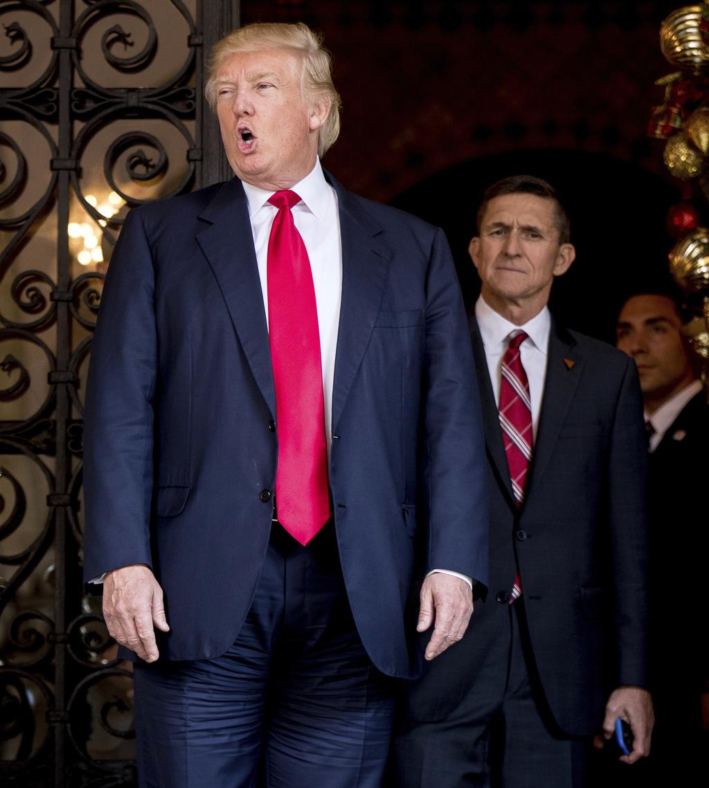 President-elect Donald Trump, left, accompanied by retired Gen. Michael Flynn, a senior adviser to President-elect Donald Trump, center...