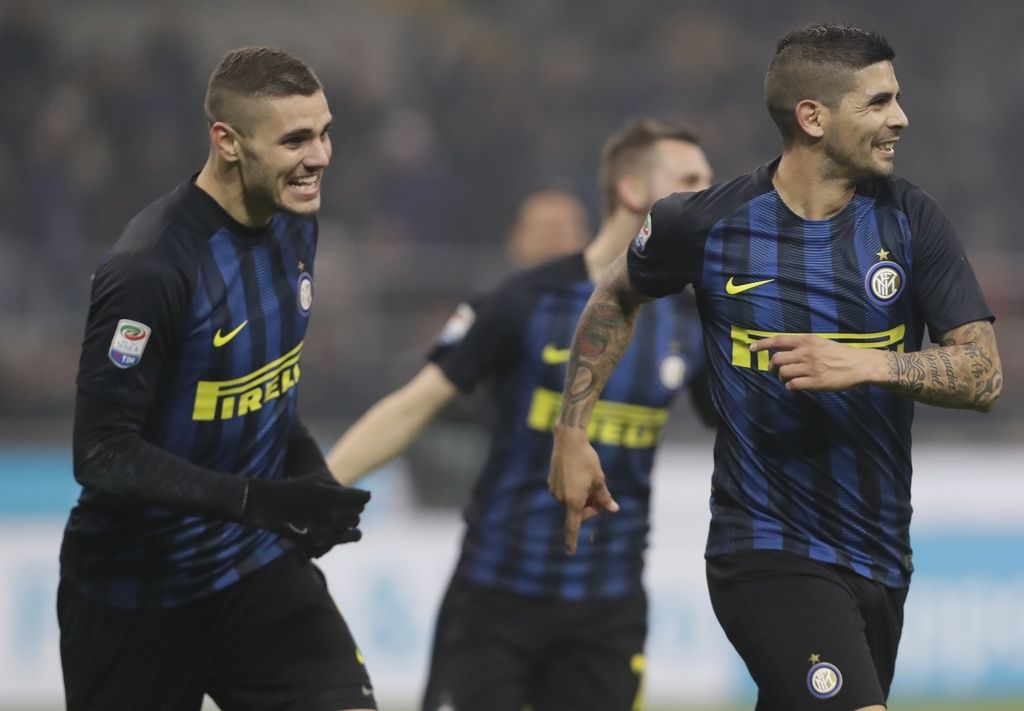 Inter Milan's Ever Banega, right, celebrates with teammate Mauro Icardi after scoring during a Serie A soccer match between Inter Milan...