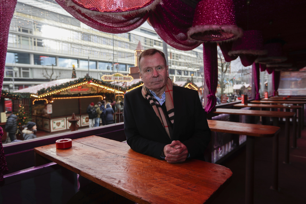 Eye witness Axel Kaiser poses for a photo at his restaurant at the reopened Christmas market, three days after a truck ran into the cro...