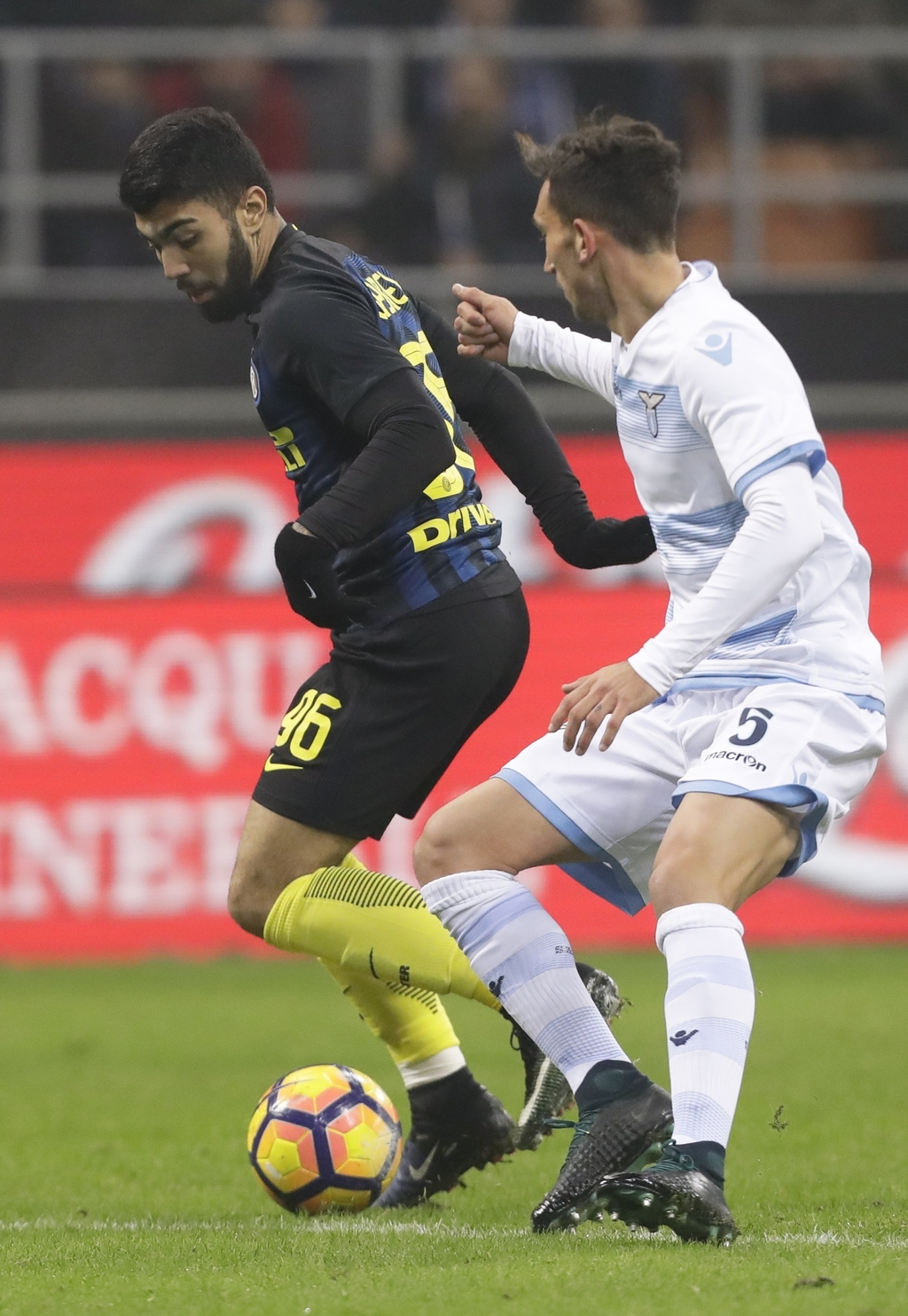 Inter Milan's Gabriel Barbosa, left, controls the ball past Lazio's Dino Cataldi during a Serie A soccer match between Inter Milan and ...