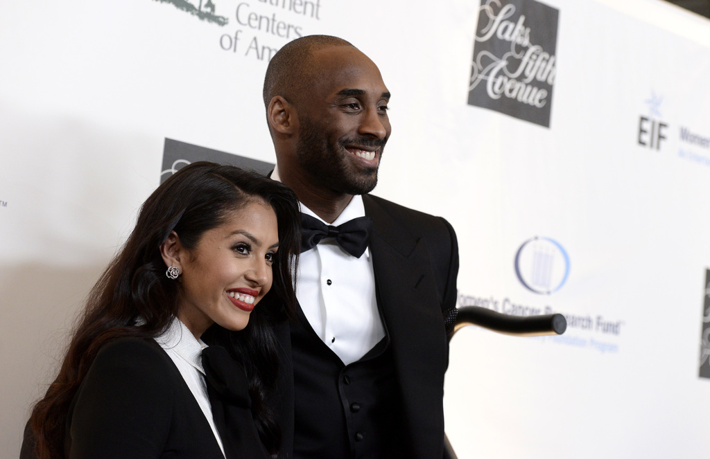 """FILE - In this May 2, 2013, file photo, Lakers guard Kobe Bryant, right, and his wife Vanessa Bryant arrive at """"An Unforgettable Evenin..."""