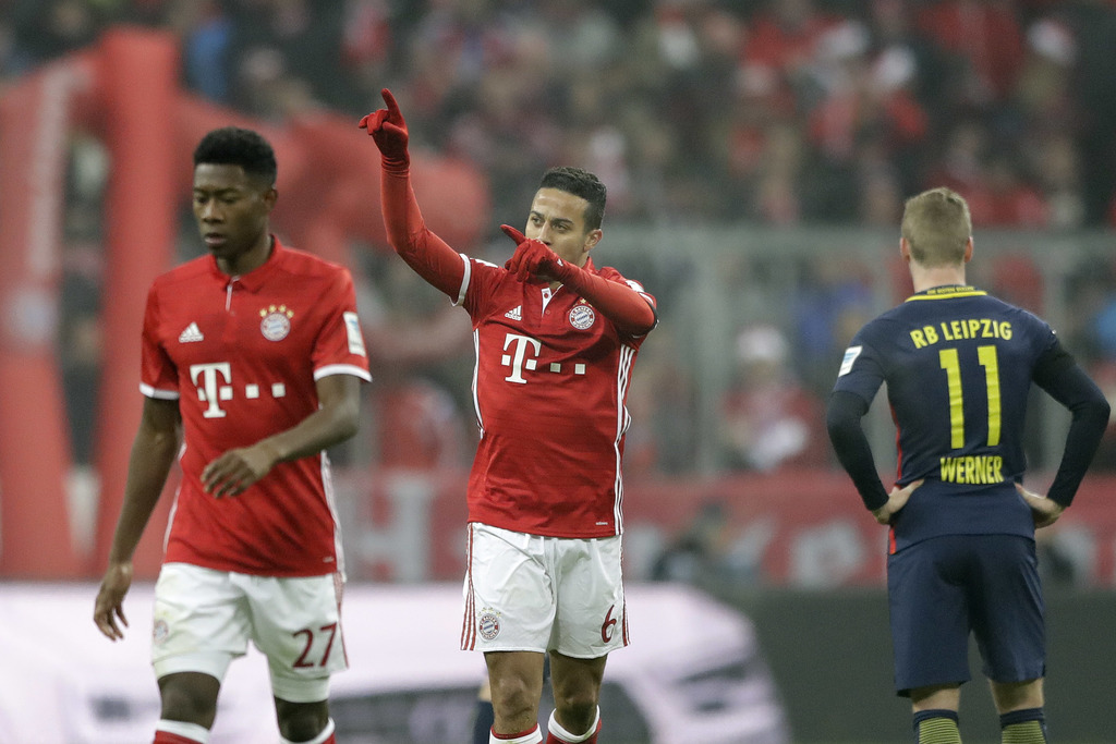 Bayern's Thiago (6) celebrates after scoring his side's first goal during the German Bundesliga soccer match between FC Bayern Munich a...