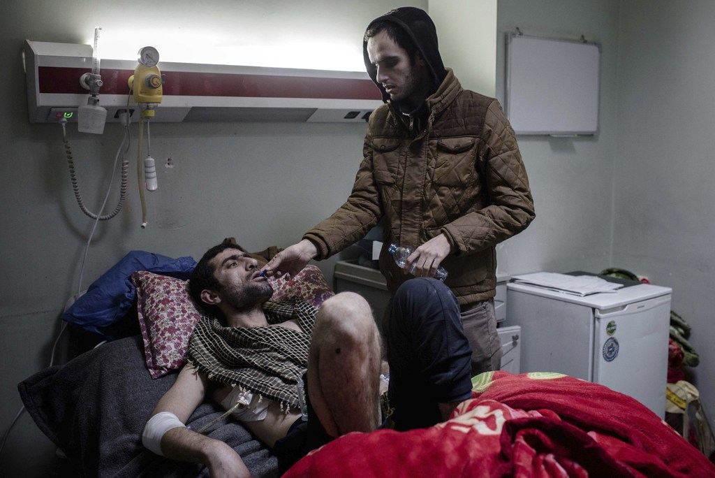In this Wednesday, Dec. 21, 2016 photo, Manhal Ahmed lies in a hospital bed at West Emergency Hospital in Irbil, Iraq on December 21, 2...
