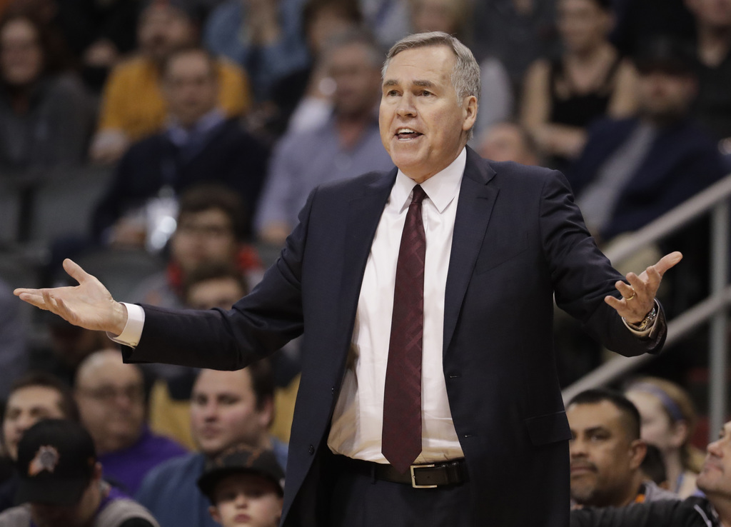 Houston Rockets coach Mike D'Antoni gestures during the first half of the team's NBA basketball game against the Phoenix Suns, Wednesda...