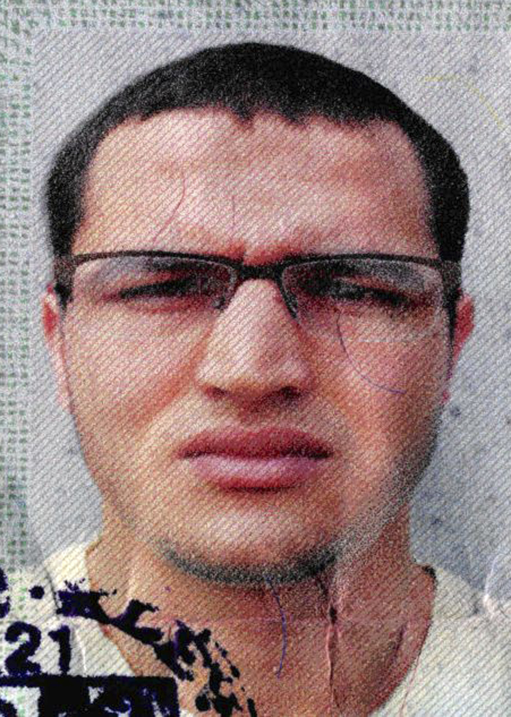 The photo issued by German federal police on Wednesday, Dec. 21, 2016 shows 24-year-old Tunisian Anis Amri on a photo that was used on ...