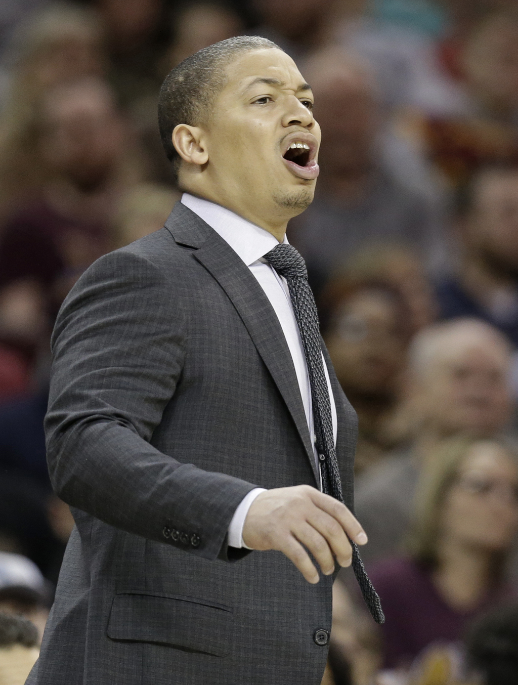 Cleveland Cavaliers coach Tyronn Lue yells to players during the first half of an NBA basketball game against the Milwaukee Bucks, Wedn...