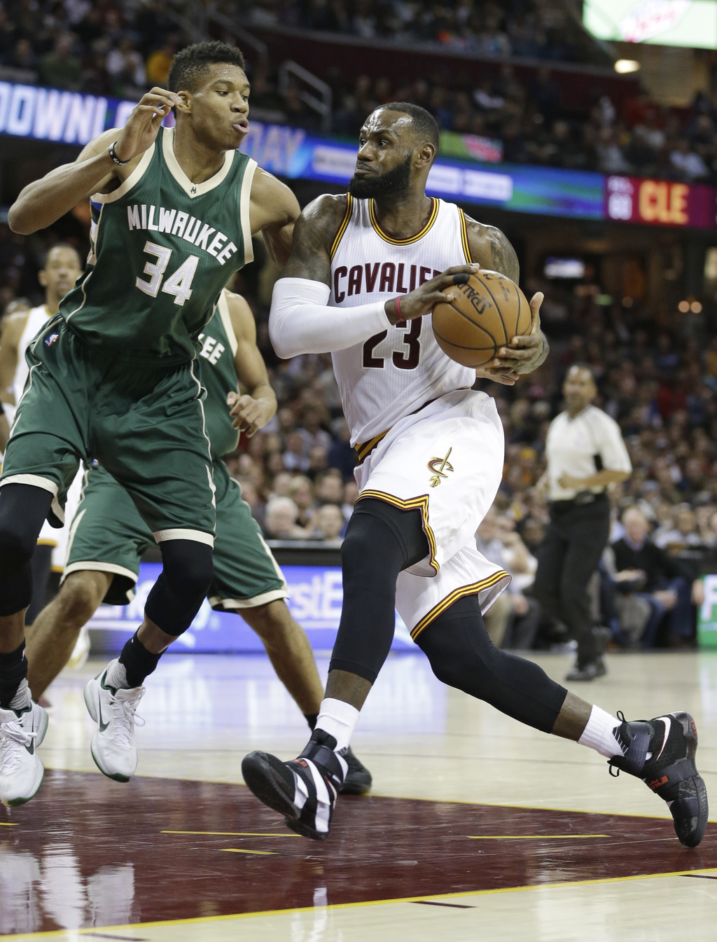 Cleveland Cavaliers' LeBron James (23) drives past Milwaukee Bucks' Giannis Antetokounmpo (34) during the first half of an NBA basketba...