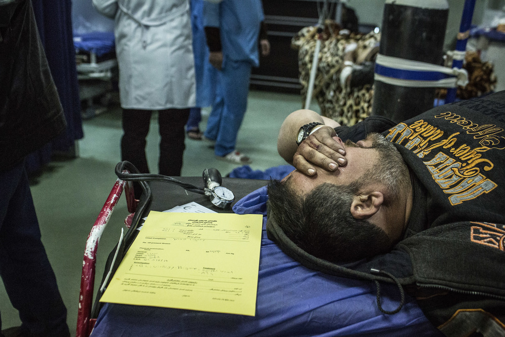 A Iraqi man wounded in a car bomb attack in the liberated district of Gogjali in Mosul waits to be attended by doctors at a Hospital in...