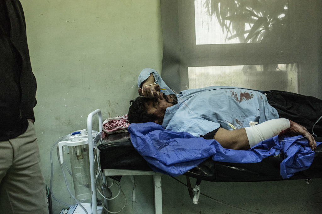 A Iraqi man wounded in a car bomb attack in the liberated district of Gogjali in Mosul is seen while waiting to be attended by doctors ...