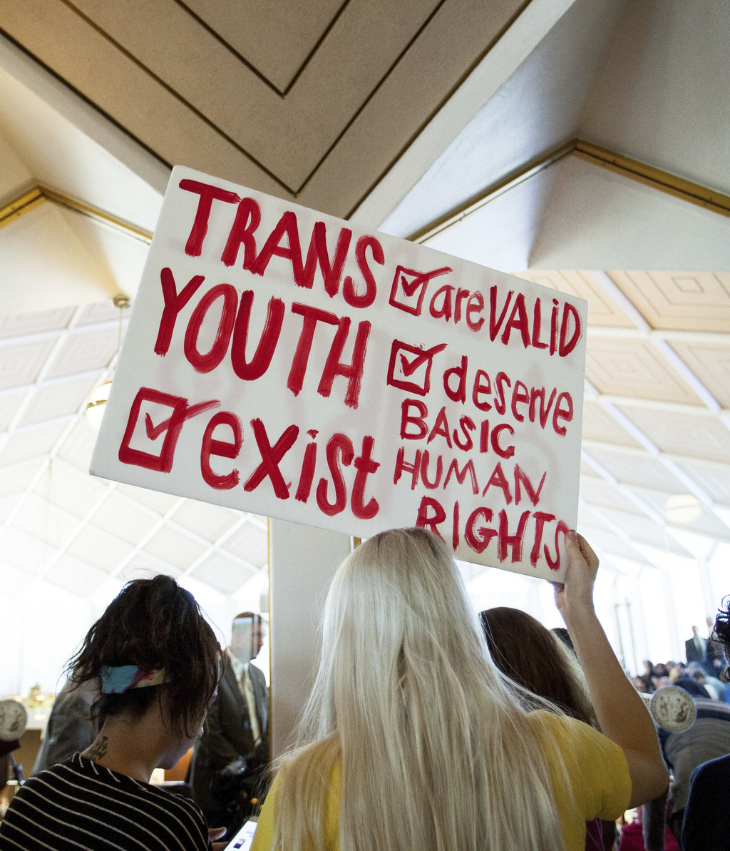 Hunter Schafer, of Raleigh, holds a sign in favor of repealing North Carolina HB2 during a special session of the North Carolina Genera...