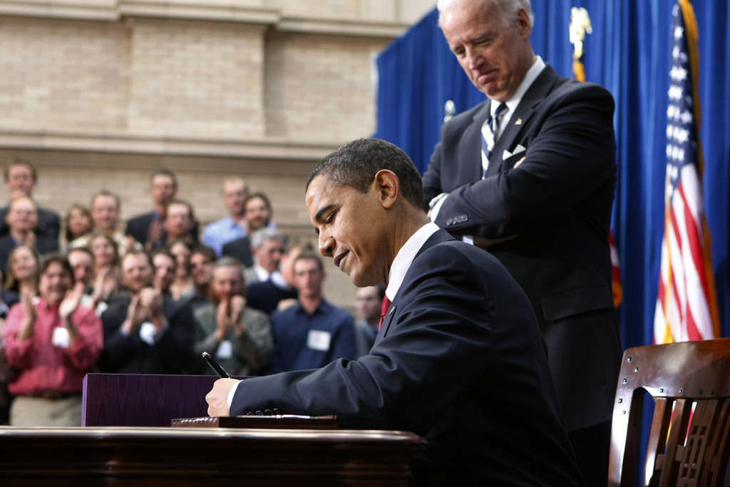 FILE - In this Feb. 17, 2009, file photo, Vice President Joe Biden watches as President Barack Obama signs the American Recovery and Re...