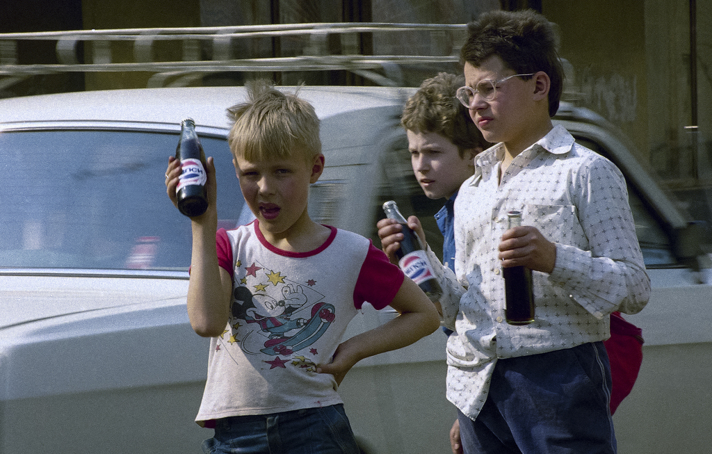 FILE - In this Wednesday, May 27, 1992 file photo, Moscow students on school vacation are seen selling Russian bottled Pepsi Cola soft ...