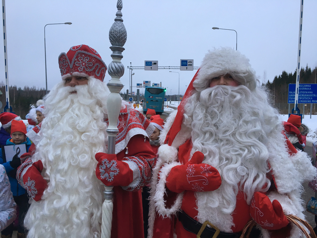 Finland's Santa, right, and Russia's Grandfather Frost meet at the two countries busiest joint border crossing  in Nuijamaa, Finland on...