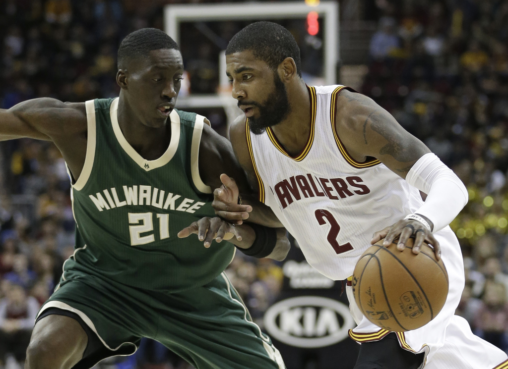 Cleveland Cavaliers' Kyrie Irving (2) drives past Milwaukee Bucks' Tony Snell (21) during the first half of an NBA basketball game, Wed...