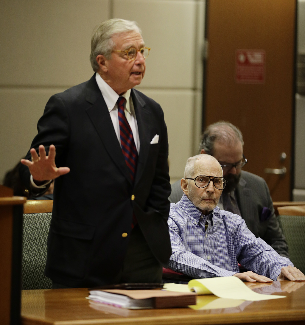 Real estate heir Robert Durst, right, sits in a courtroom as his attorney Dick DeGuerin talks to the judge during a hearing Wednesday, ...