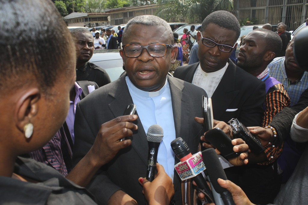 Priest Donatien Nshole, First Deputy Secretary-General of the National Episcopal Commission, speaks to journalists after a meeting in K...