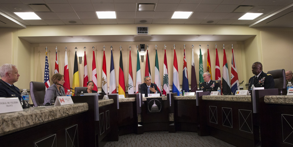 FILE - In this Oct. 14, 2014, file photo, President Barack Obama speaks during a meeting with more than 20 foreign defense ministers on...