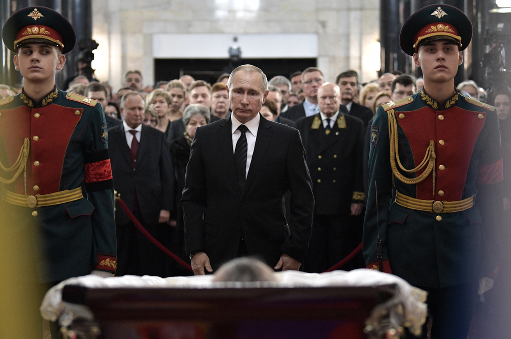 Russian President Vladimir Putin, center, attends a farewell ceremony for the Russian Ambassador to Turkey Andrei Karlov at the Foreign...