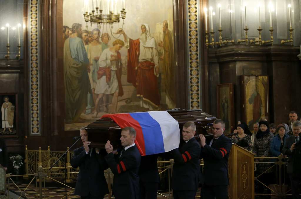 A coffin with a body of killed Russian ambassador to Turkey, Andrei Karlov is carried for a religious service inside the Christ the Sav...