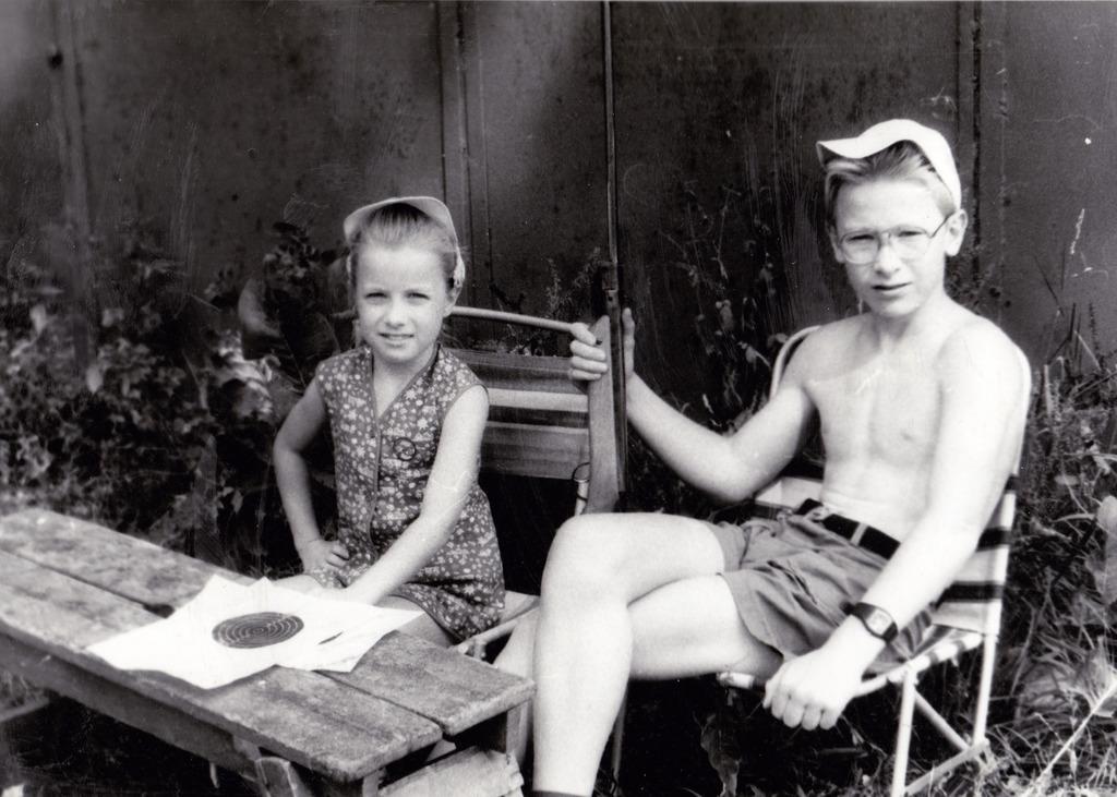 In this 1992 family handout photo, Nataliya Vasilyeva, left, sits next to her brother in Pushkino, Russia. AP's Nataliya Vasilyeva, who...