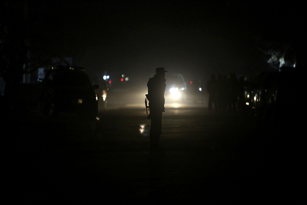 Afghan security forces patrol the site of attack on an Afghan parliament member's house in western Kabul, Afghanistan, Wednesday, Dec. ...