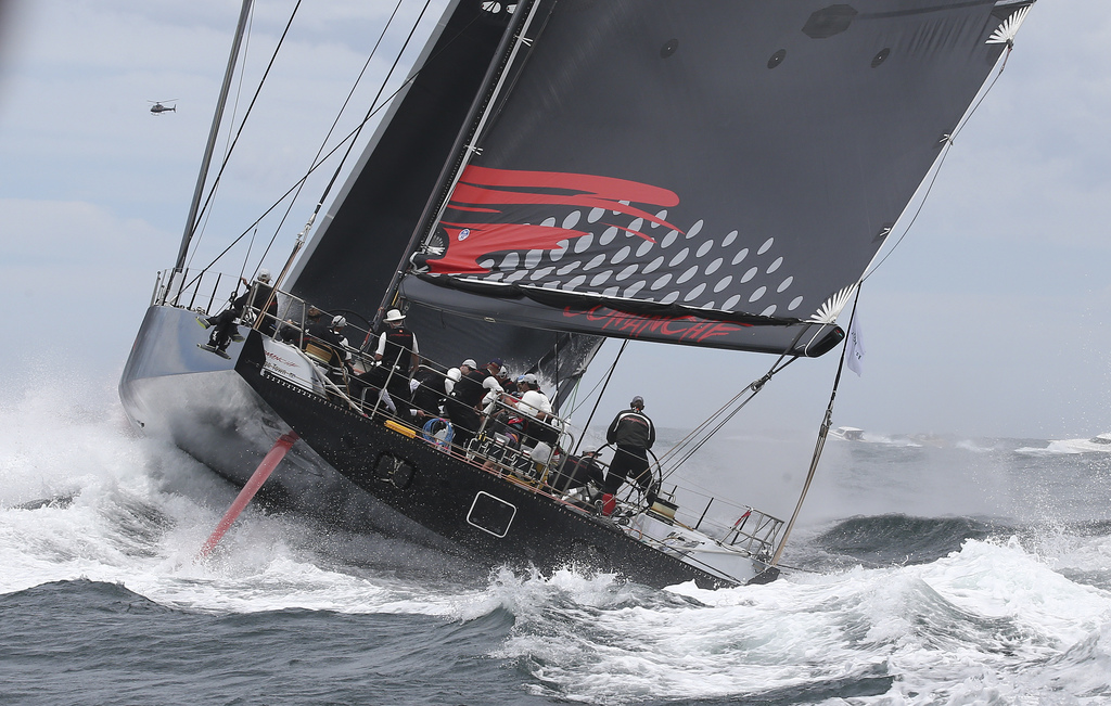 FILE - In this Dec. 26, 2015 file photo, Comanche sails out of the heads during the start of the Sydney Hobart yacht race in Sydney.  L...